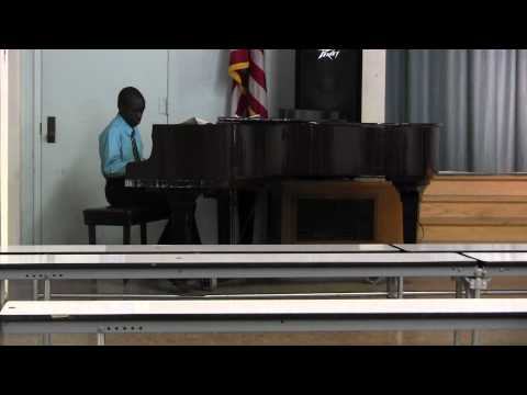 Daaton playing the piano for his G.A.T.E culmination.