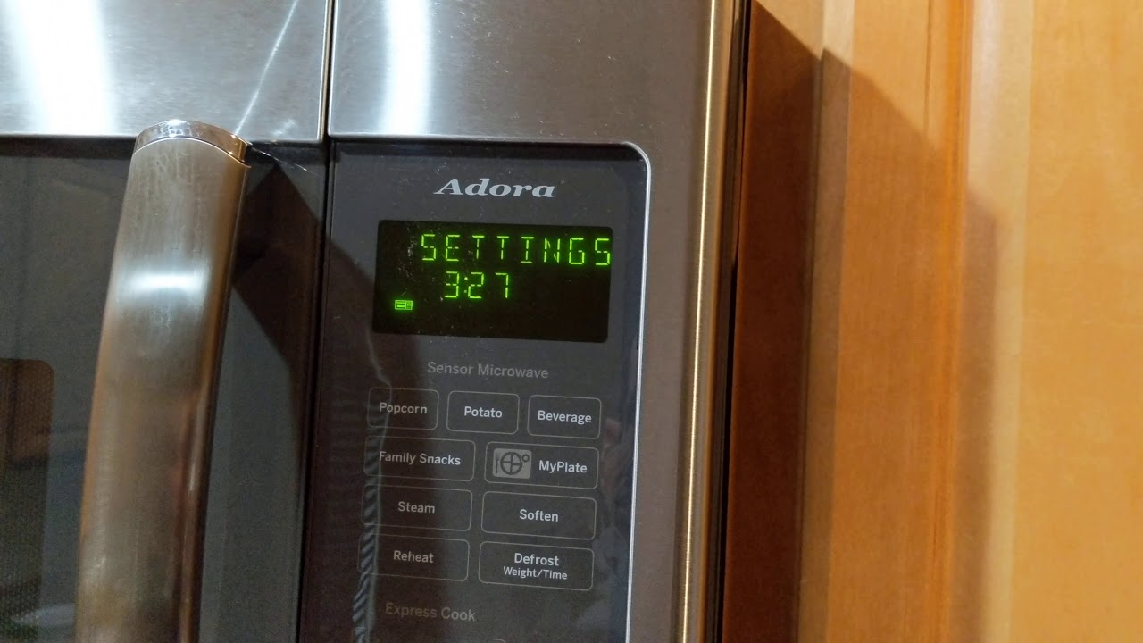 how to set the clock on a ge microwave