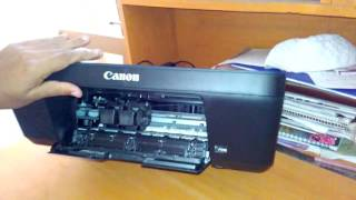 How to replace/change/open ink cartridge from canon pixma E400 printer(This video shows how you can change or replace or open ink cartridge from canon pixma E400 printer and refill your cartridge. change your printer cartridge., 2016-03-05T07:34:17.000Z)