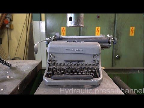 Crushing typewriter with hydraulic press