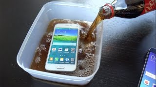 Samsung Galaxy S5 Mini Coca-Cola Freeze Test - Will It Survive? (4K)(Official Instagram Account: http://instagram.com/adrianisenofficial All business inquiries (Review requests, sponsorships, etc) send a detailed message to: ..., 2015-05-06T17:59:50.000Z)