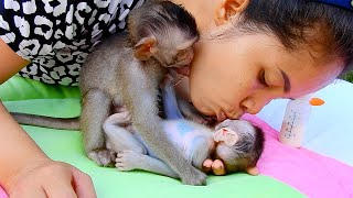 Mom can't stop loving both adorable babies - Mom kiss comfort Jerry so sweet after milk