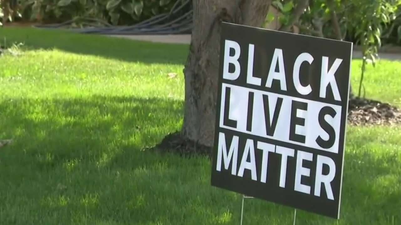 Macomb Township couple claim being singled out by HOA for Black Lives Matter sign