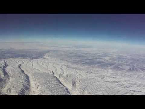 Denver-to-Honolulu flight climbs over snowy Front Range of Colorado Rockies 2011-01-02