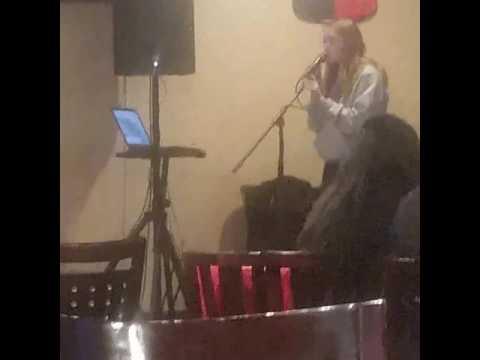 Miranda singing karaoke Machupicchu
