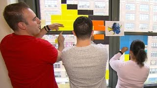 NYC office workers wage Post-it note battle