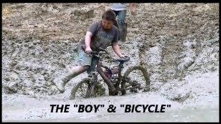 (#23) BOY AND BICYCLE (MUDDY) AT DIAMOND-S-MUD BOG