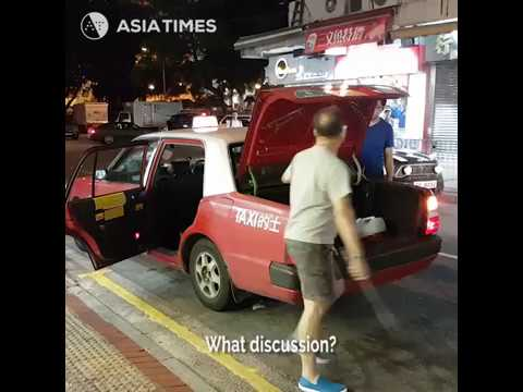 Taxi driver threatens couple - Hong Kong
