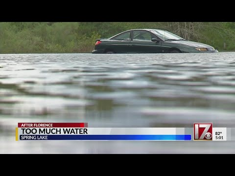 Spring Lake residents wait for flood waters to recede