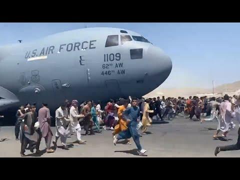 Watch: Afghans Run Alongside U.S. Military Plane At Kabul Airport