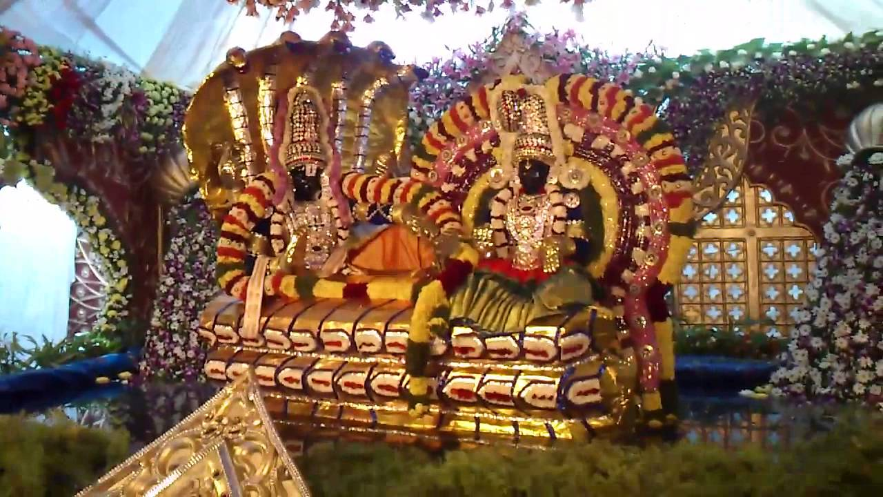 indian god decorated with flowers and fruits in tirumala