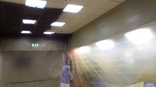 Ceiling tile coating a fraction of replacement costs