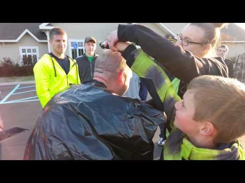 Jeff Hall getting his head shaved by Yjam kids!