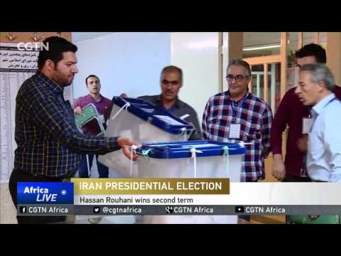 Hassan Rouhani wins second term