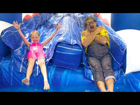 Nastya has fun at home on a large children's trampoline  