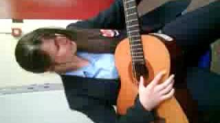Judith playing guitar Thumbnail