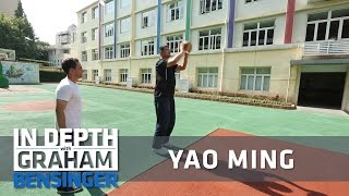 Yao ming takes reporter to old schoolyard
