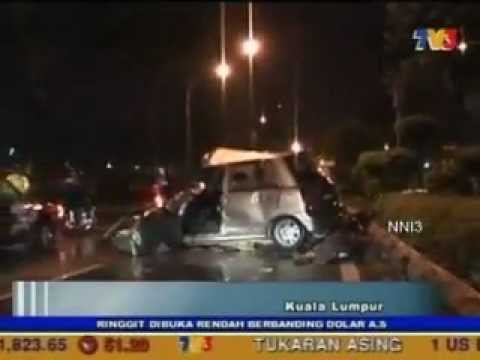 The New Straits Times Online  Two die after car crashes into lorry.flv