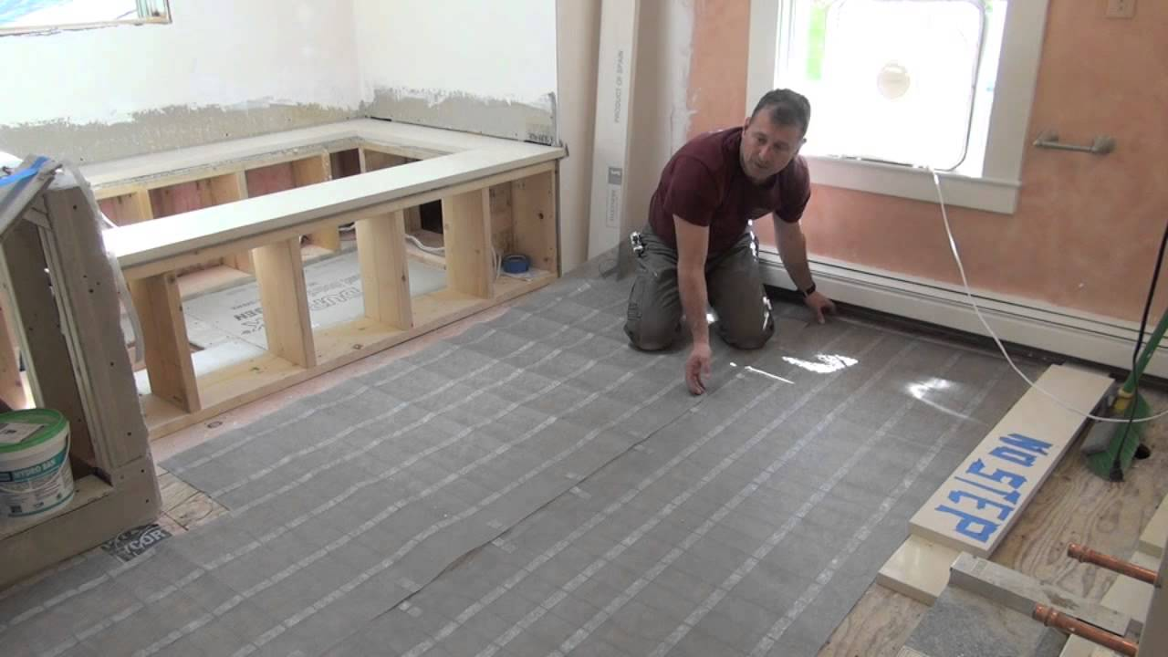 Remodeling a bathroom part 10 electric radiant floor heat youtube dailygadgetfo Image collections