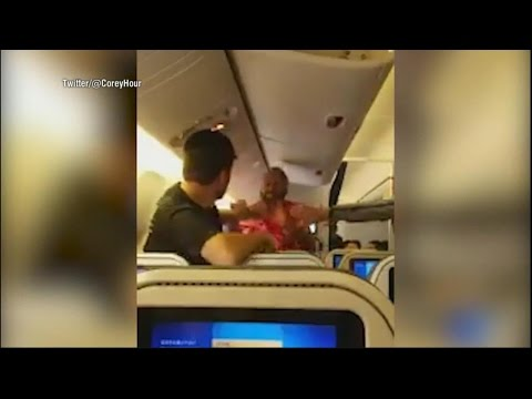Thumbnail: Video shows two men fighting on flight from Japan to Los Angeles | ABC News