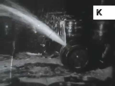 1920s USA, Prohibition, Men Smash Barrels of Booze, Archive Footage