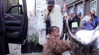 Proud mother Kim Kardashian watches her adorable daughter North play with a Bull