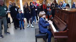 Olivier (8 years old) and Terry Miles play the piano.