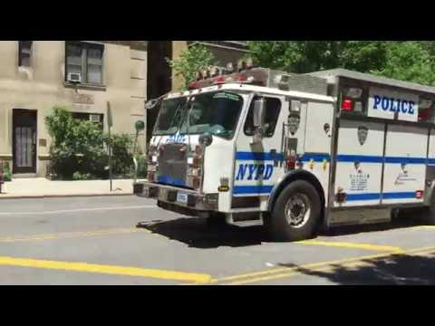 NYPD EMERGENCY SERVICE SQUAD TRUCK 2 RESPONDING URGENTLY WITH AIR HORN ON WEST END AVENUE IN NYC.
