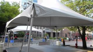 20' x 20' Tentology frame tent with stage and wheelchair ramp for festival