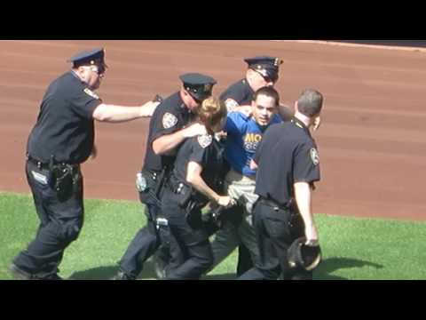 Fan Runs onto the Field at Yankee Stadium