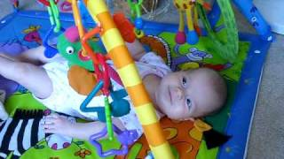 baby playing in a baby gym/activity mat