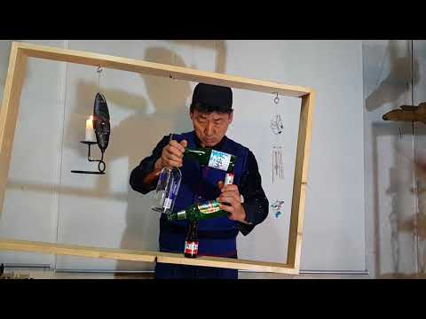 RockyByun Balancing -making a square with bottles on the shaking frame