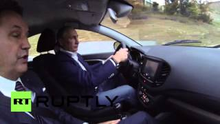 Russia: Putin takes to the wheel of the new Lada Vesta