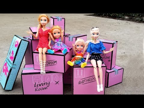 Playhouse surprise ! Elsa and Anna toddlers - moving truck - unpacking - LOL