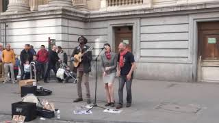 Reggae Busker singing three little birds (Street Performance)