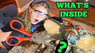 WHATS INSIDE the GREMLIN? CUTTING OPEN a GREMLIN w/ Aubrey & Caleb!