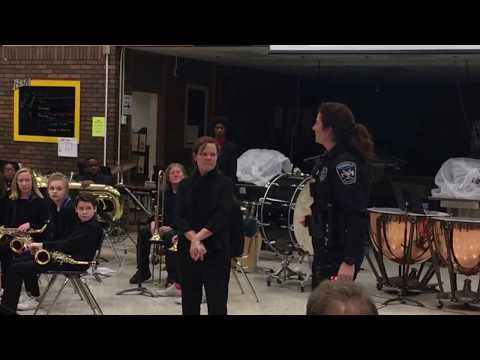 Burnsville Police Officer Surprises Band Teacher with Instrument Donation