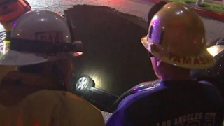 Raw: LA Sinkhole Swallows Cars Amid Storms