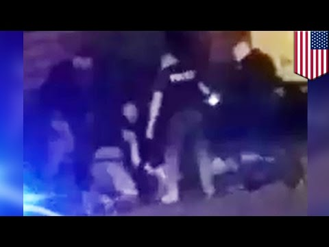 Cops beat up black man: Cell phone video shows Philadelphia cops beating an unarmed man - TomoNews