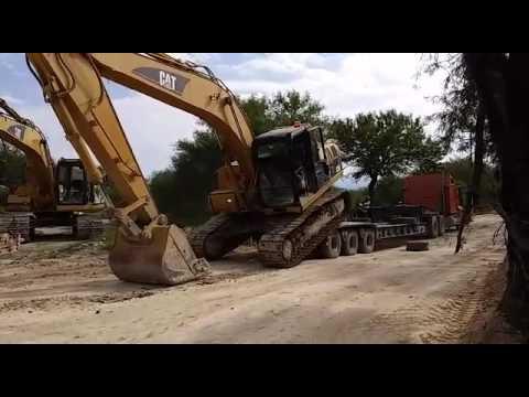 Excavadora Cae Del Cama Baja