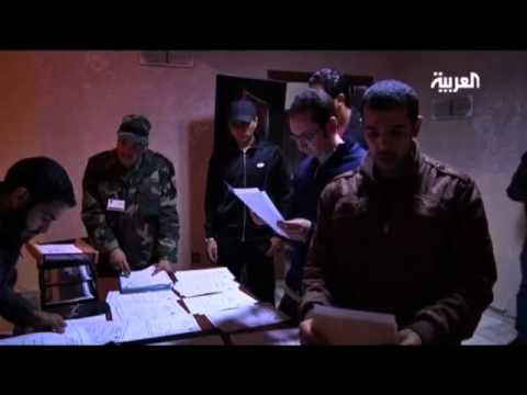 Libyan government inducting rebels