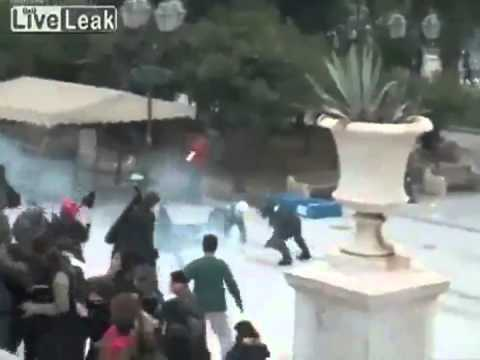 Greek Cop Lit on Fire by Taking Molotov Cocktail to the Head