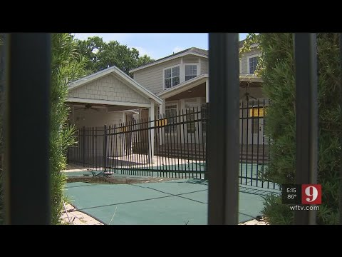 After double lot sold to separate owners, one of them erects fence through pool and garage