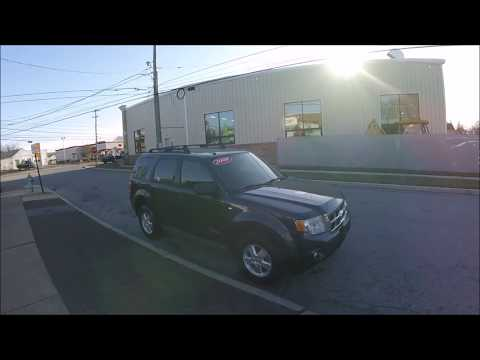 2008 /Tan Ford Escape XLT 4WD V6 (1FMCU93108K) with an 3.0L V6 DOHC 24V engine, 4-Speed Automatic Overdrive transmission, located at 577 Chester Pike, Prospect Park, PA, 19076, (610) 237-1015, 39.886154, -75.302338 - Photo #0