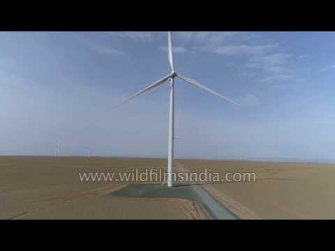 Wind energy in the Gobi desert of Mongolia: massive windmill turbines operate in desert vastness