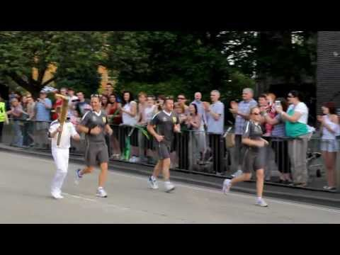 The Olympic torch goes past Worcester College of Technology.