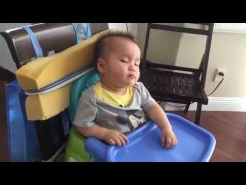 Baby boy falls asleep in high chair