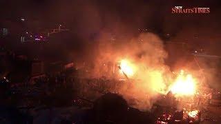 Massive Kuala Perlis blaze razes 13 homes, 2 shops