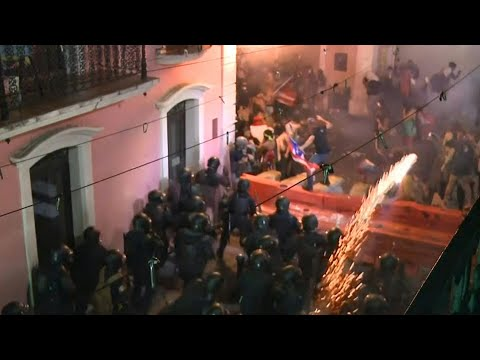 Police fire tear gas at protesters calling for PR governor to resign