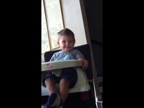 Dancing toddler in highchair